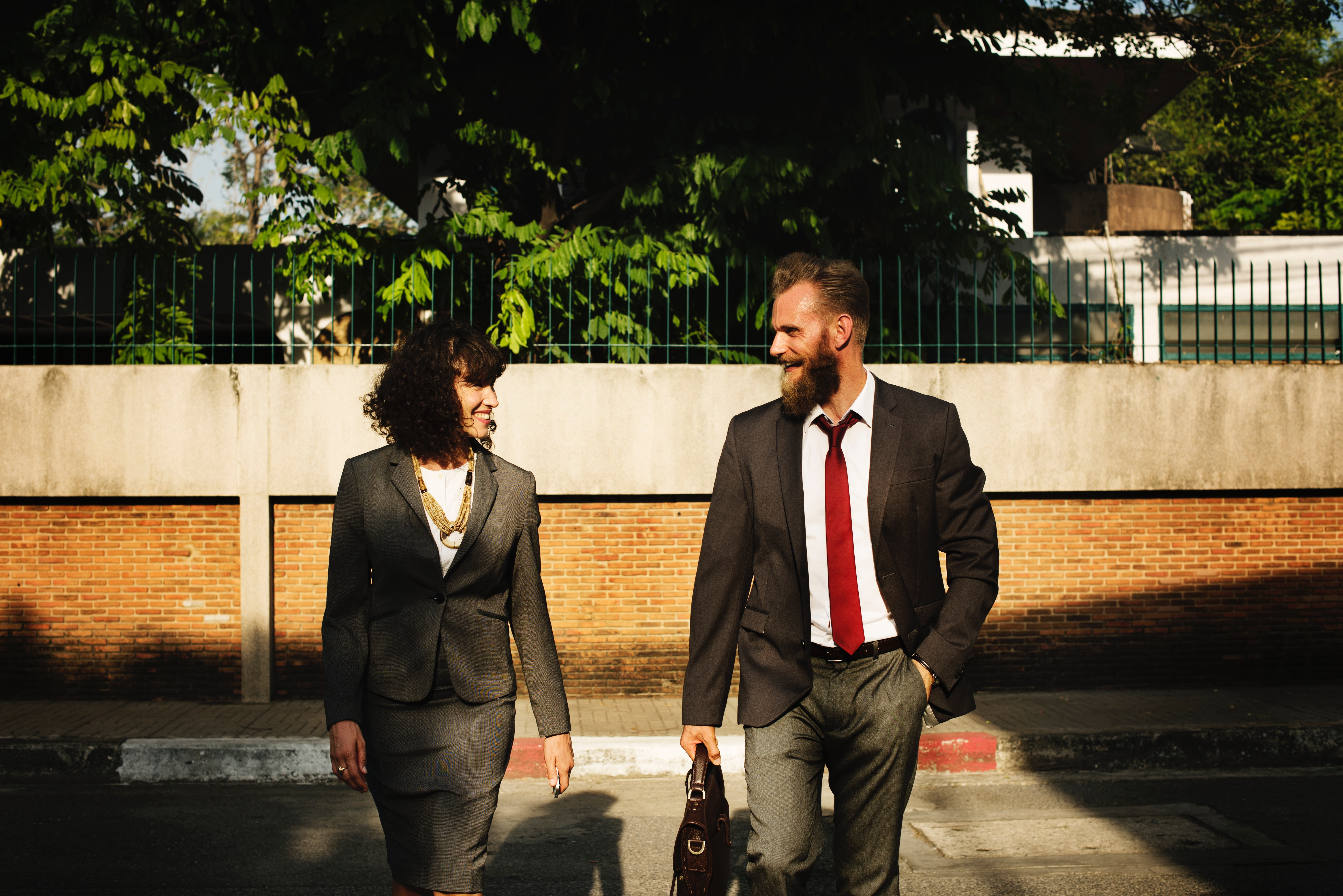 man and woman walking to work
